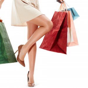 Woman's legs and Shopping Bags Isolated on White