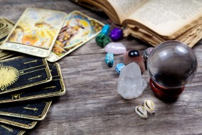 Fortune-telling tools on wooden table