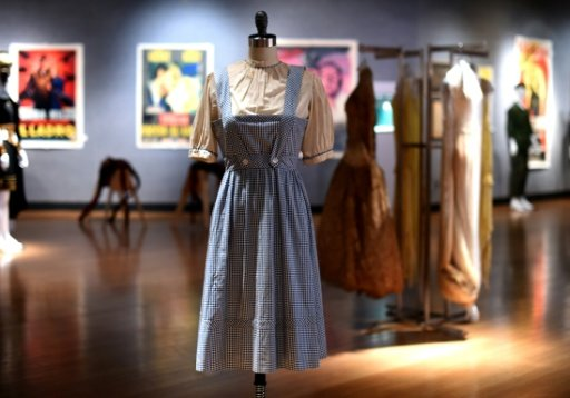 The iconic Wizard of Oz Dorothy dress goes for $1.56 million.