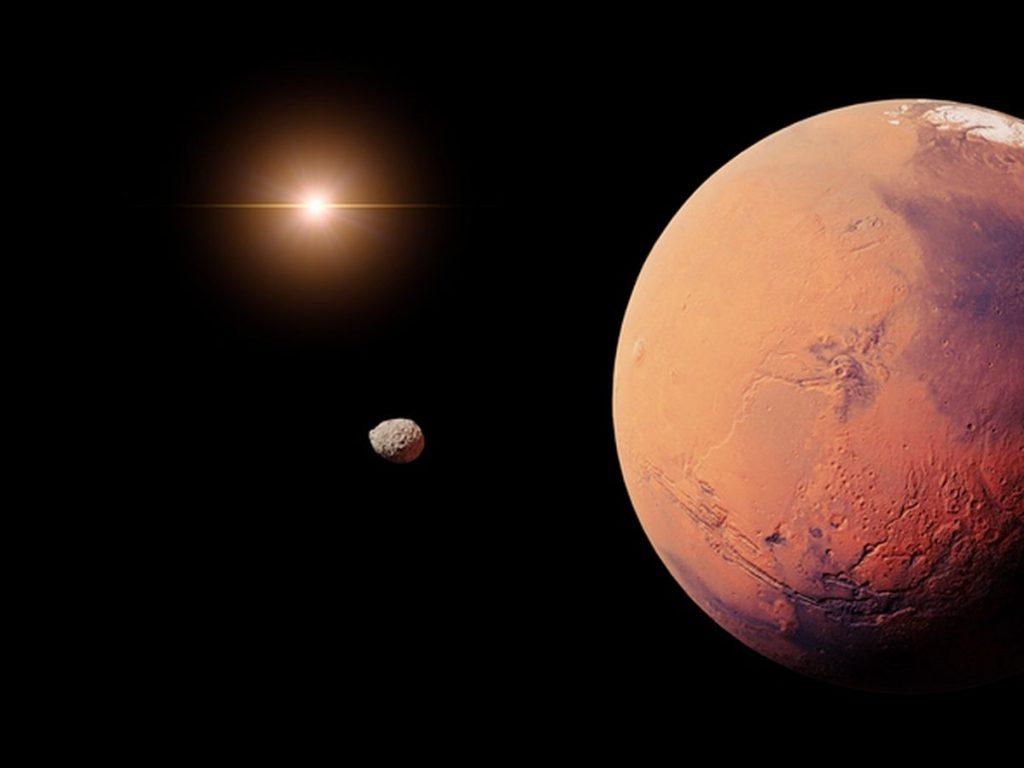 Moon twin hiding behind Mars
